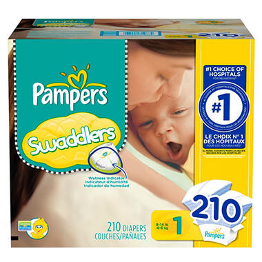 The next size up (Stage 1) was still too big for baby making it a no-win situation with the Huggies. The Pampers Preemie diapers fold perfectly around baby's bum and when the diaper is affixed around her waist, the legs gussets seal nice and snug.
