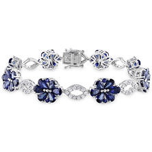 12.5 ct. Sapphire and 1.25 ct. t.w. Diamond Floral Bracelet in 14K White Gold