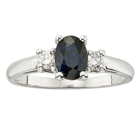 Three Stone Oval Sapphire Ring with .20CT. T.W. Diamond Set in 14K Gold