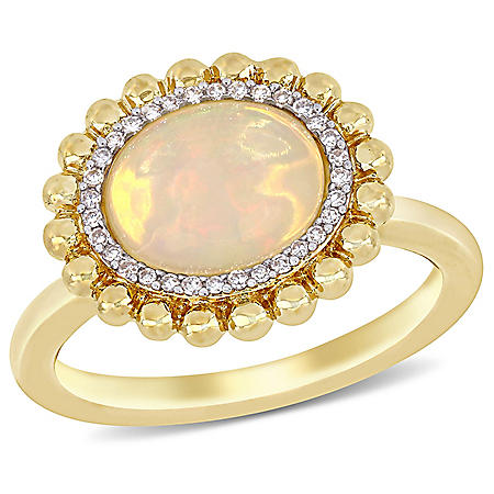 2.75 CT. T.W. Oval-Cut Yellow Ethiopian Opal and Diamond Accent Double Halo Ring in 14K Yellow Gold