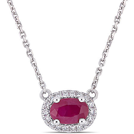 0.57 CT. T.G.W. Ruby and 0.09 CT. T.W. Diamond Oval Halo Necklace in 14k White Gold