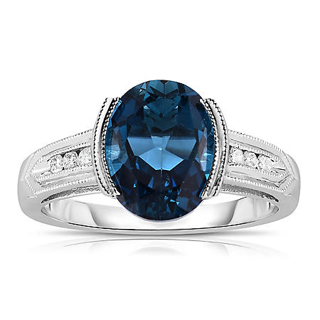 Oval-Shaped London Blue Topaz Ring with Diamonds in 14K White Gold