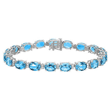 27 CT T.W. Oval Cut Blue Topaz and Diamond Bracelet in 14 Karat White Gold