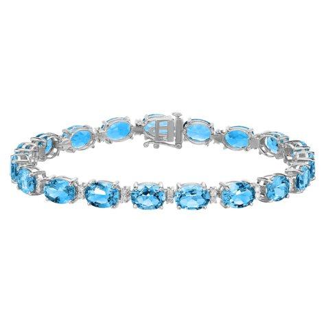 27 CT T.W. Oval Cut Blue Topaz and Diamond Bracelet in 14 Karat White Gold